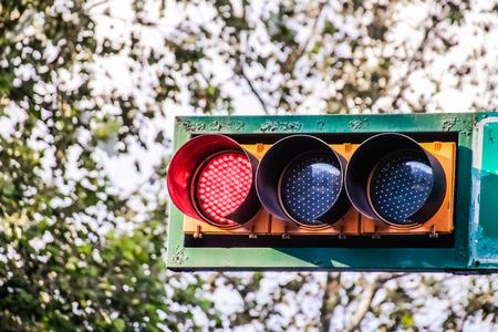 Photograph of a traffic light on urban scenario