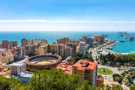 Photo pour Aerial panoramic view of Malaga city with the bullring, Andalusia, Spain in a beautiful summer day seaside - image libre de droit