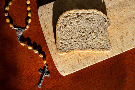 Photo for Bread and rosary beads lent concept before easter - Royalty Free Image
