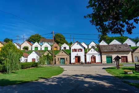 Photo pour many colorful old traditional wine cellers in Villanykovesd in a hungarian wine region called Villany . - image libre de droit