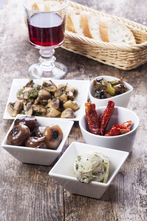 different italian antipasti and red wine