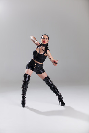 dominatrix in leather with a whip