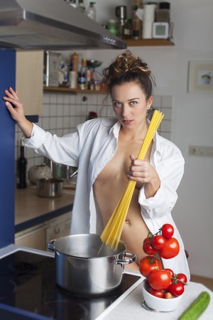 nude woman cooking spaghetti