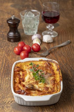 Photo pour overview of a cooked lasagna on wood - image libre de droit