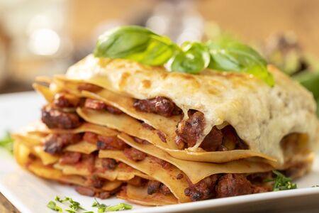 Photo pour closeup of a portion of lasagna  - image libre de droit