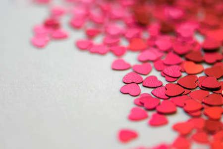 Foto de Red glitter hearts on white background. Selective focus. Valentine´s Day. - Imagen libre de derechos