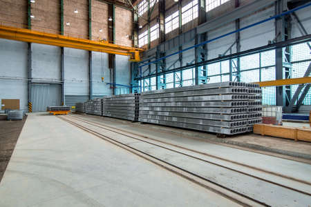 Photo pour a line for the production of hollow floor slabs with an overhead crane and folded new slabs. - image libre de droit