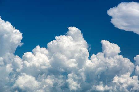 Photo pour Large white clouds against the blue sky, a natural phenomenon of the weather before the rain. - image libre de droit