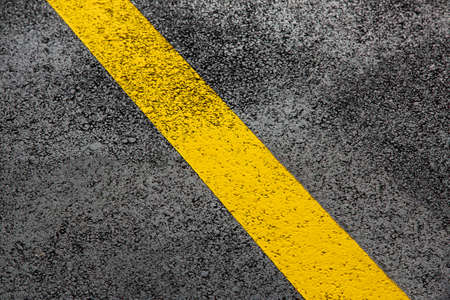 Photo for yellow markings of the new highway with tarmak road surface close up asphalt texture, nobody. - Royalty Free Image