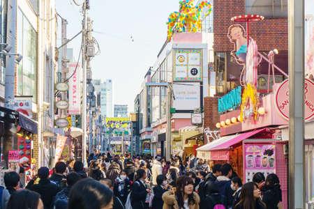 Tokyo, Japan - January 26, 2016: Crowds walk through Takeshita Street in the Harajuku . Tokyo , Japan
