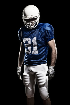 Football Player with number on a blue uniform  Studio shot