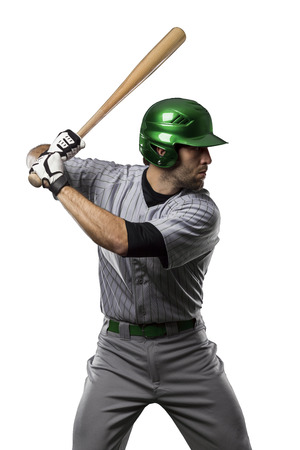 Baseball Player in a Green uniform, on a white background.の写真素材