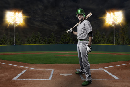 Baseball Player on a Green Uniform on baseball Stadium.の写真素材