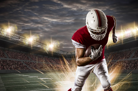 Photo for Football Player with a red uniform running on a stadium. - Royalty Free Image