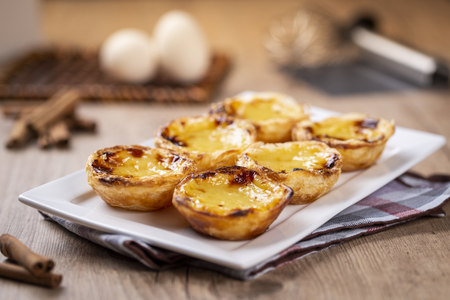 Typical Portuguese custard pies - Pastel de Nata or Pastel de Belem. traditional portuguese pastry.