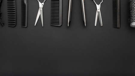Foto de Flat lay composition with Hairdresser tools: scissors, combs, hair iron on black background. Frame. Hairdresser service. Beauty salon service. Hairdresser Set. Long banner background with copy space - Imagen libre de derechos