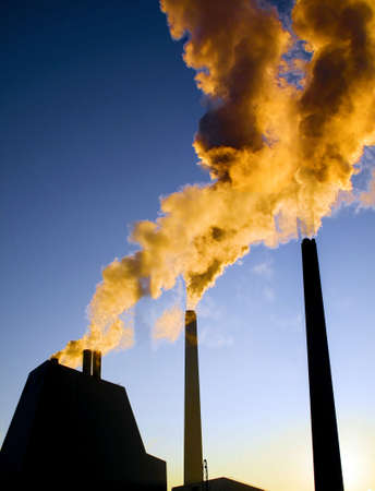 Highly polluted smoke escaping from industrial chimneys
