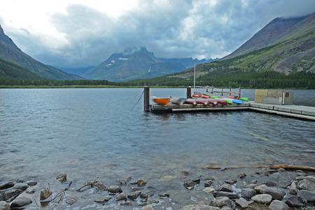 Small boats at a dock in Glacier National Park.