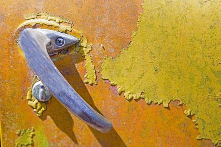 Photo pour Closeup truck door handle on orange and yellow paint. - image libre de droit