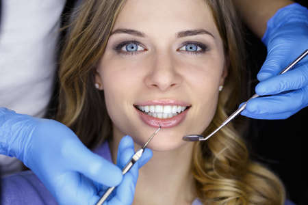 Photo pour Girl with beautiful white teeth on reception at the doctor dentist. - image libre de droit
