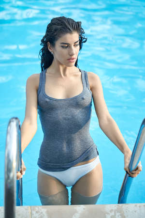 Model in swimming pool outdoors