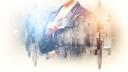 Photo pour Double exposure of businesswoman hold credit card - image libre de droit