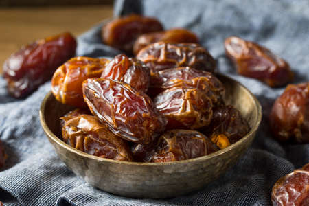 Photo for Organic Dry Red Dates in a Bowl - Royalty Free Image