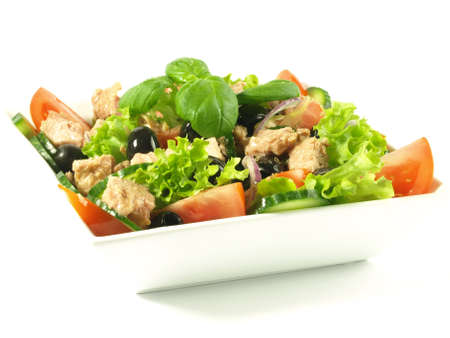 Close-up of tuna salad with tomato, lettuce and olives