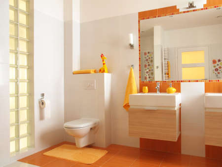 Friendly bathroom for children with orange tiles and flower decors,