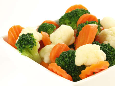 Close up of steamed vegetables on isolated backgroundの写真素材