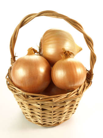 Wicker basket full of onions on isolated background
