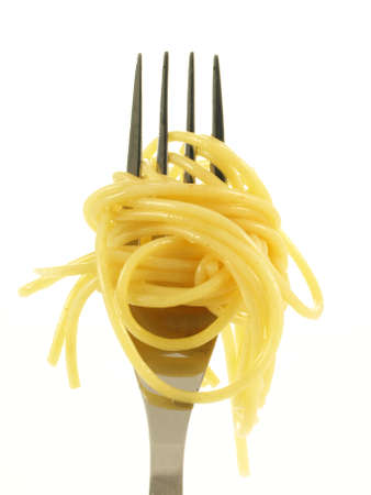 Spaghetti noodles on fork on isolated background