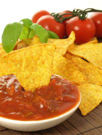 Bowl with mexican salsa and spicy nachos