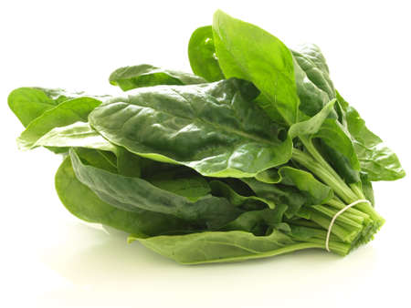 Bunch of spinach leaves on isolated white background