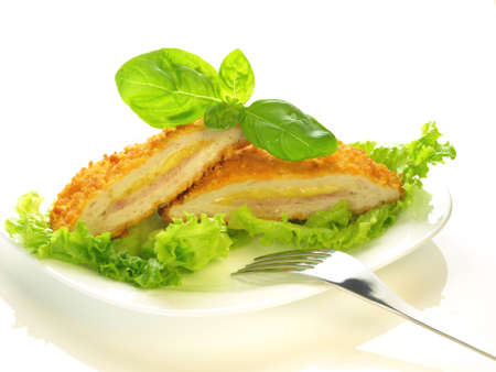 Cordon bleu cut in half on isolated background