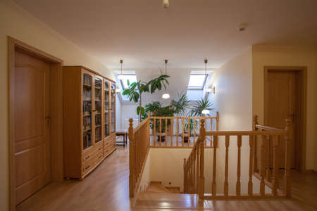 Wooden stairs, doors and shelves on the attic