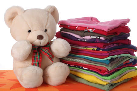 Colorful children's clothes with a teddy bear