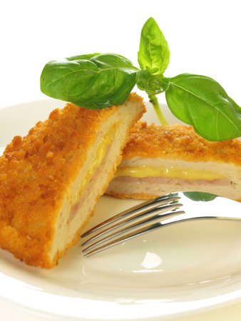 Stuffed cordon blue cutlet served on a plate on isolated background