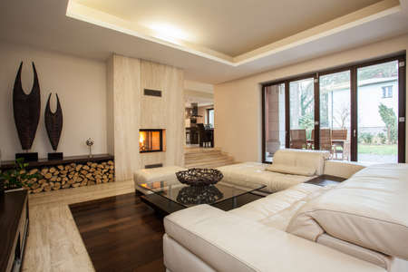 Travertine house: contemporary living room with fireplace