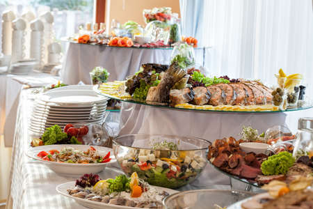 Different colorful snacks on a banquet tableの写真素材