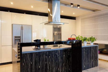 Urban apartment - Black counter top in modern kitchen
