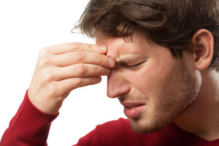 Man holding his nose because of a sinus pain