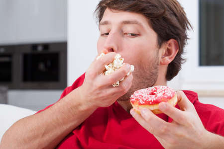 Man can't help eating sweet and junk food