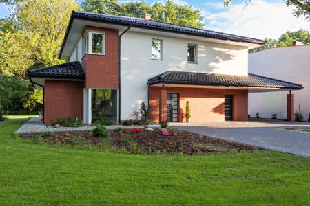A modern villa with a trim garden