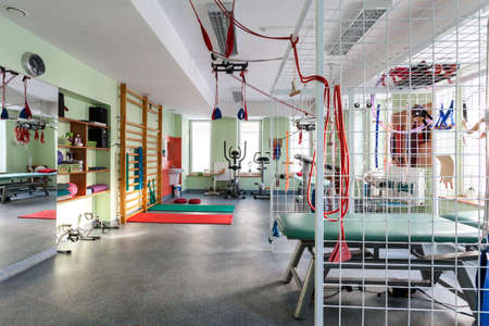 Colorful modern gym equipped with exercise machines