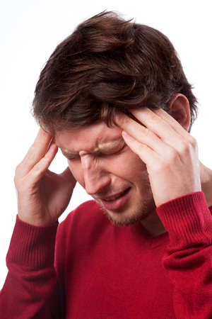 Young man suffering from migraine on isolated background