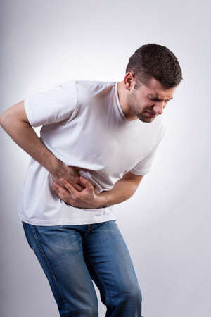 Young man suffering from stomach ache