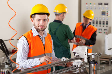 Male production workers working during production process