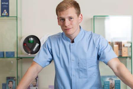 Close-up of a young man working at spa salon, horizontal