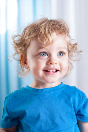 Portrait of a cute little child with big blue eyes